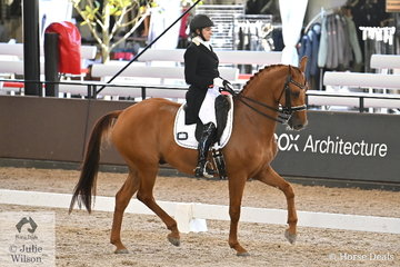 Pauline Carnovale rode her Dutch import by Johnson, 'Captain Cooks' to win the Grand Prix Freestyle CDN. with 71.205%.