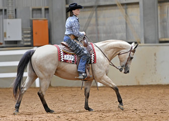 Janette Wallace riding Kool Tomcat in the Select Amateur Ranch Riding.