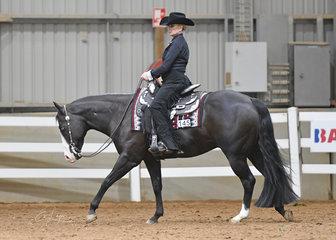 Emily Singleton riding Circle K Cowboy Casanova in the Novice Amateur Westerm Horsemanship.