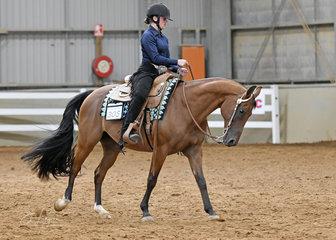 Hanna Rush riding Triandibo Roc N Lynx in the Junior Youth Western Horsemanship 7-13 years.