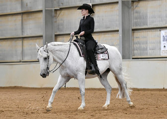 Peta Hicks riding The Grey Coupe in the Senior Youth Western Horsemanship 14-18 years.