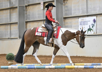 Tiffany Walter on Taly S So Good To Kiss in the Amateur Junior Horse Trail.
