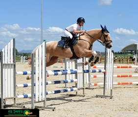The crowd was left asking how she did it - Elkee Lang-McMahon from Kolora Lodge and 'Flash Az' took an impressive angle onto the final fence in the Open 1m AM5 Jump Off round to come home with a time of 36.55 and taking first place.