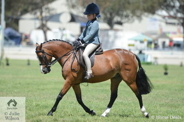 Holly Backman is pictured aboard Daizi Plumb and Kara Woolcock's nomination, 'DP Popeye' during the class for Child's Show Hunter Pony N/E 12hh.