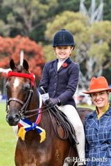 Champion Large pony - argyl star quality ridden by Erin Bowers, with judge Sabrina Neave