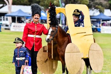 "Winners of the Horse Deals sponsored Fancy Dress class - dressed as the royal guard and carriage is pony Woranora Napoleon (who was also champion small pony) Hugh Laird, Nicole Butcher (née Riemer) and ""prince"" Harry Armistead Riemer."