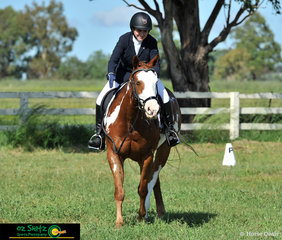Painted pony Killer Queen receives praise from rider Akira Moir after the completion of their EvA 80 Junior dressage test at the Tamworth International Eventing held at AELEC.