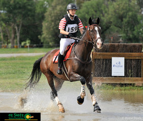 Splashing through the water of class CCN1*-S - A at the Tamworth International One Day Event is rider Amelia Brydon on Asellus