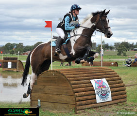 Jumping the final fence out of the water is Jellystone Park Manhatton and Demi Rowlandson in the CCI 2 Starat AELEC.