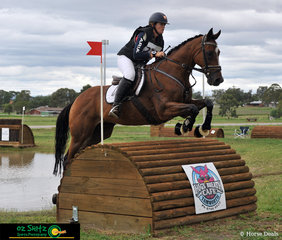 Jumping clear in the two star cross country of the Tamworth International ODE is rider Hannah Kelley on Red Lord as she goes over the roll top at nine B.