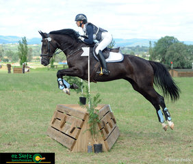 Competing in the EVA80 class Grace Kay on Sia confidently jumping part b of the fence nine corners.
