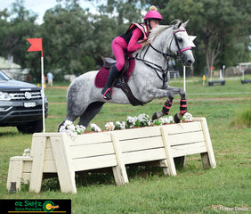 Looking pretty in pink is Poppie Gorton on FFS Broomhilda as she jumps over fence sixteen three jumps from home in the EVA80 junior class.