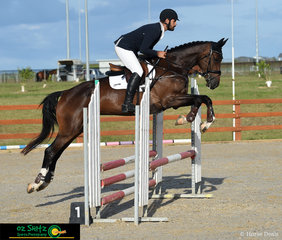Jumping around the arena is Belcam Le Noah with rider Luke Harmer in the EvA80cm at Tamworth International Eventing.