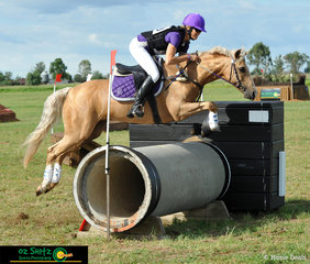 Looking pretty in purple over the new Oz Shotz camera jump on the EvA 95 Cross Country course were horse and rider combination Kaywana Crown Jewel and Jodie Hollis at Tamworth International Eventing. .