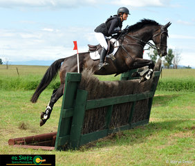 Big smiles by Elsa Ribal-Vigneau on Black Judgement as they soar over jump eleven of there class CCN one star the Ditch Pallisade.