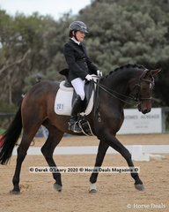 "Denise Ceddia placed 2nd in the Medium 4A riding ""Cooramin Bernini"" with a score of 63.403%"