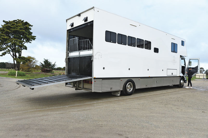 The rear ramp, although quite steep, has heavy duty rubber and secure cleats for easy ascent. Also the last bay doors open either side to act as a guide for loading and unloading. There is also a black caravan curtain wall for the back with a zip door.