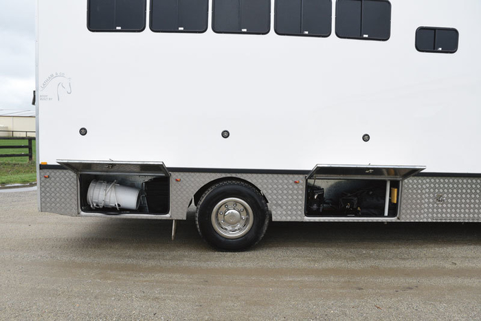 """More storage. The high gloss one piece fiberglass side of the truck is covered with a 3M product called Clear Guard. """"I did not want to put press studs or tracking for a vinyl protection sheet. The Clear Guard that Tony Bayley put us onto protects the sides when horses are tied to it. It is a kind of self-repairing plastic that can be replaced."""""""