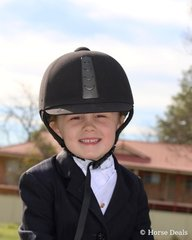 All smiles –Third-generation Byalee Stables rider Kara Delaney was all smiles after her first-ever dressage test on 37yo Byalee Baby.