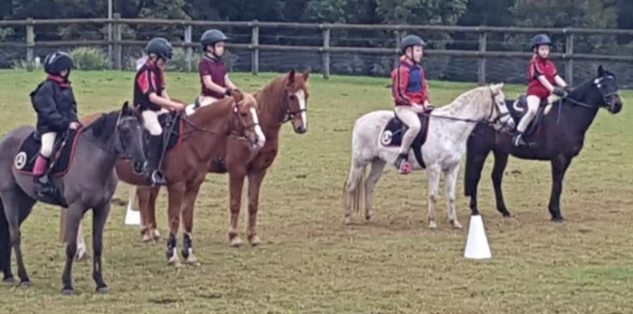 Adam (centre) on his first rally day with Arcadia Pony Club.