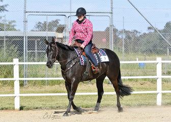 Jane Piggott and Buckledown Masquerade, competing in the Improver Western Horsemanship.