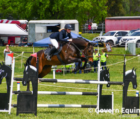 Maddison Brighton and Anembo Jedi making a stylish jump in the 1.20m on Day 1