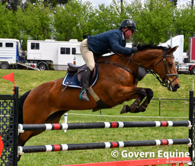 Competitive as ever Deon Williams and Versace Vision cut across a fence to win the 1.20m on day 1