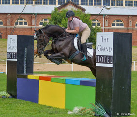 Casey Louttit and Vader make a nice jump over the Grand Hotel wall in the opening class of the weekend the 90cm