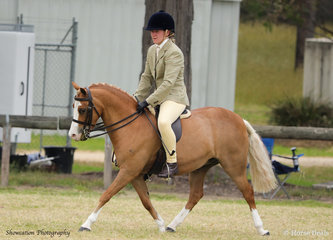 Mirrabella Park Azura is pictured with Mia Young on their way to winning Reserve Champion Show Hunter Pony