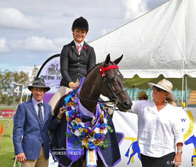 """The winner of the Off The Track Series Final """"She's Amazing"""" exhibited by Louise Refalo, ridden by Sarah Olsen, pictured with judges Hugh Bowman and Wendy Pollard."""