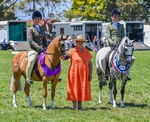 Ring 1 judge Sharon Greenhill is pictured with her Champion Hunter Pony Bamborough Juene & Arielle Stella & Shari Ryan Woerz on Calca Park Aristocrat Reserve champion