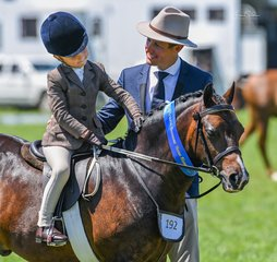 Tim Eurell was very happy with his adorable jockey and pony after a win in the Leading rein hunter pony class.
