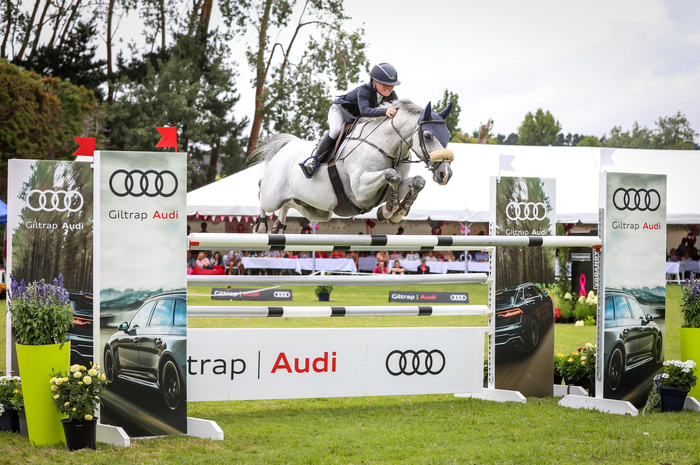 Annabel Francis and Carado GHP flying to victory in the POLi Payments FEI World Cup (NZ) Final at the Giltrap Audi World Cup Fesitval at Woodhill Sands this afternoon. Photo by Cheleken Photography