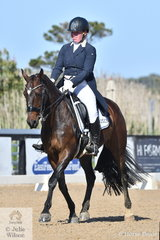 Taleah Cameron is pictured aboard her 'Equine Affair Blackjack' during the Junior Freestyle on the fourth and final day of the Homes & Acreage Boneo Park Summer Dressage Championships.