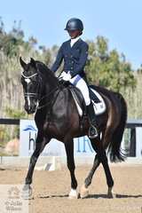 Lucy Peters is pictured riding her, 'Sahara Storm' in the Horseland Junior Freestyle on the final day of the Homes & Acreage Boneo Park Summer Dressage Championships.