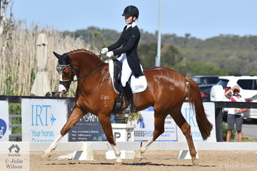 Kate Kyros from South Australia was the only interstate rider in the main arena today.  She did her state proud by winning the Horseland Junior Freestyle with 72.2% riding the lovely, 'Courtlands Cadman' by BJ Kaneto Casanova.
