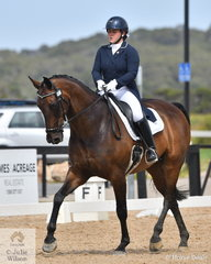 Mackenzie Bright is pictured aboard, 'Grand Flemingho' by Flemmingh out of a Grandkavalier mare during the Young Rider Freestyle.