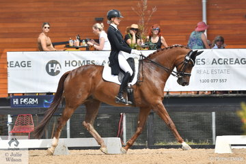 Talented 16 year old, Jessica Dertell had a busy and successful day. She is pictured aboard the imported 'Eskara de Jeu' by Jazz out of a Jetset D mare on their way to winning the Young Rider Freestyle with 73.90%.