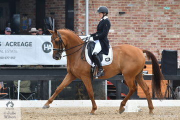 Pauline Carnovale rode her talented, 'Captain Cooks' by Johnson to produce a good Grand Prix Freestyle to some entertaining music to take second place with 73.483%
