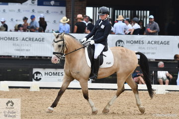 Rosemary Heagney is pictured aboard the delightful, 'Mr Buck Meister'  on their way to third place in the Alan Mance RAM Pony Freestyle.