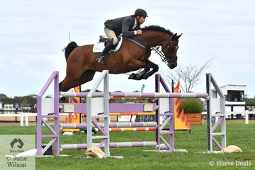 Always competitive, Olympian, Russell Johnstone rode, 'Canton' to take second place in the Future Stars class on the final day of the Homes and Acreage World Wetlands Showjumping Championships at Boneo Park.