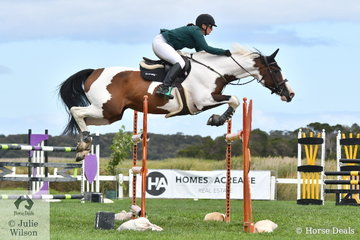 Kate Beadel is pictured aboard her wonderful mare, 'Lily Elmare'  in the first round of the Homes and Acerage Mini Prix.
