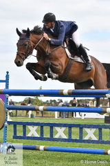Gippsland dairy farmer, Andrew Lamb makes a very good and fast showjumping rider. He is pictured aboard his home bred, 'Dennison Park Spartava' that won the Homes and Acerage Mini Prix.