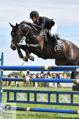 Jess Stones always enjoys the opportunity to show her talent over the jumps. The multi talented rider from The Oaks in NSW is pictured aboard her home bred, 'Chatina' during the Homes and Acreage Mini Prix.