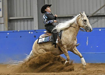 Kate Elliott riding Whizzinit Me in the Open reining