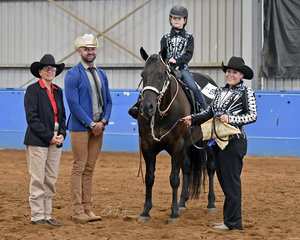 Winner of the leadline class 3-6 years, Katrina Marden on board Winsome Docs Digby, with Rachelel Marden, and judges Conny Barry and Craig Rath.