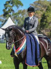 Steph Barrington added many broad sashes to the Romsey Park teams collection over the weekend including yet another Championship with her princess mare Rebelle pictured after their win of the large Owner Rider Hunter Hack over 15hh class.