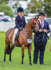 Well known Jeremy Roberts looked very sharp in his suit and bowler to be Sarah Abrahams & Andharra All Miracles handler in the Leading Rein Show Pony 12hh & under Rider 5 & under 8 years class.