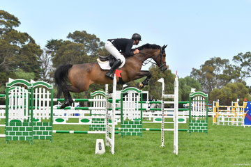 Tom McDermott jumped one of just four clear rounds in the start list of 23 riding his imported Clinton mare, 'Elegance de la Charmille'. They had the fastest time in the second round, but a fence down relegated them to third place.
