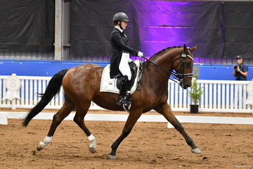 Lindsey Ware is pictured riding her , 'Aristede' by Aachimedes during the Grand Prix Freestyle.